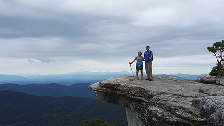 High Peak employee hiking to Mcafee's Knob