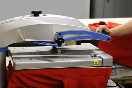 Heat press curing a direct to garment print