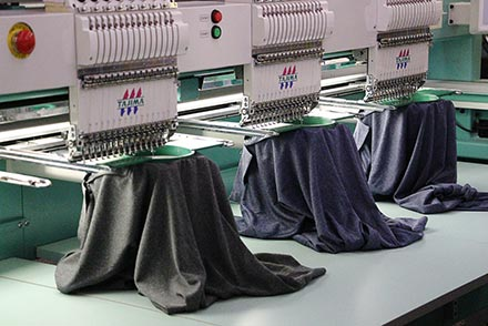 Dress shirts being embroidered