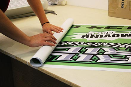 Printed banner being rolled up